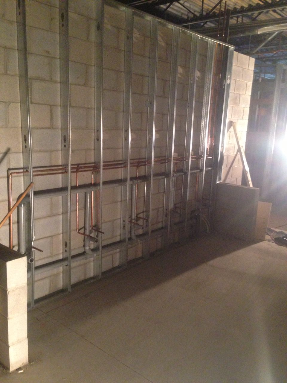 Copper pipes behind wall