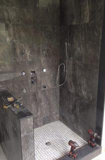 Dark tiles in standing shower