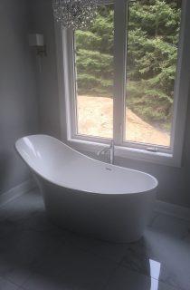 Bathtub by the window